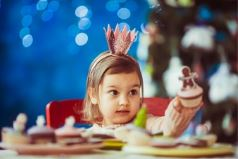 Kid party princess holding cake